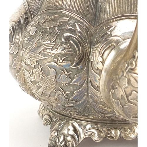 592 - Good Chinese Canton silver teapot by Khecheong, finely embossed with birds amongst a landscape, 19cm...