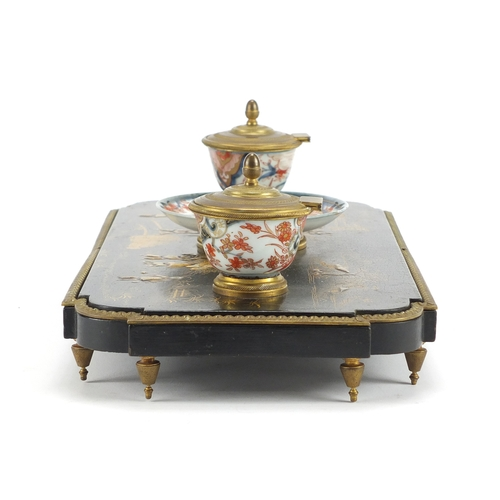 29 - 19th century French black lacquer and porcelain chinoiserie desk stand with porcelain inkwells and t...