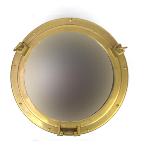 2031 - Brass ships porthole design mirror, 47cm in diameter...