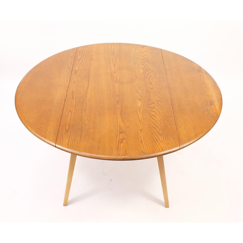 2003 - Ercol light elm drop leaf dining table and four stick back chairs, the table 71cm H x 65cm W (folded...