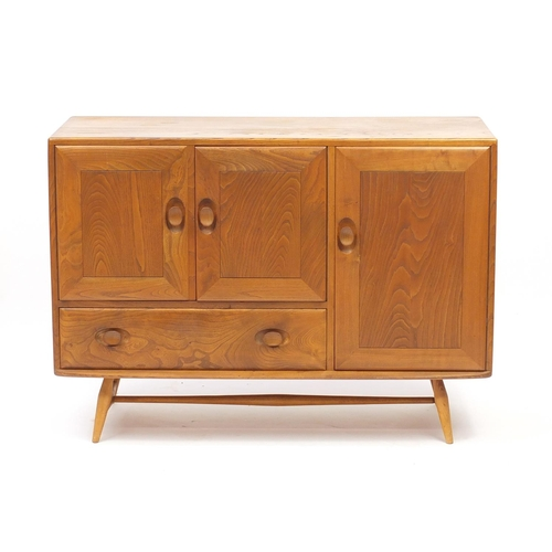 2004 - Ercol Windsor light elm sideboard fitted with three cupboard doors and a drawer, 82cm H x 115cm W x ...