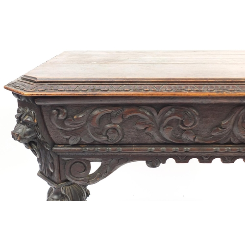 2040 - 19th century Flemish oak centre table carved with lion heads and dolphin feet, 75cm H x 100cm W x 65...