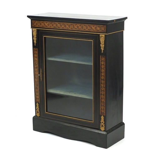 2044 - 19th century French ebonised pier cabinet with geometric inlay and ornate gilt mounts, enclosing two...
