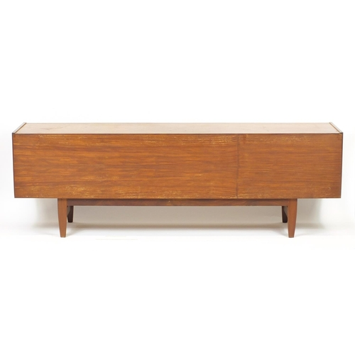 2012 - Vintage teak sideboard fitted with a fall, pair of cupboard doors and three drawers, possibly Scandi...