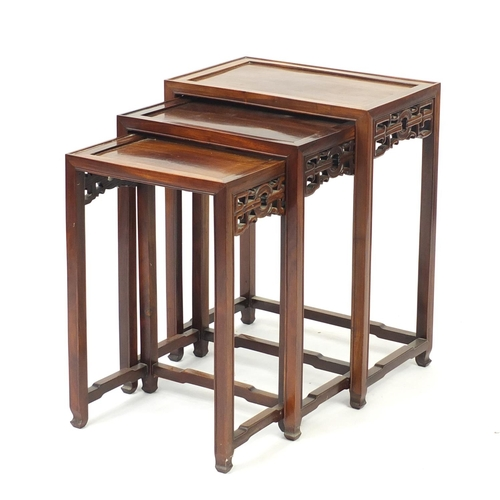 2027 - Nest of three Chinese hardwood occasional tables, the largest 65cm H x 51cm W x 32cm D...