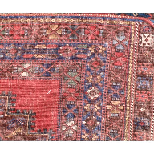 2039 - Blue and red ground rug with all over geometric design, 160cm x 133cm...