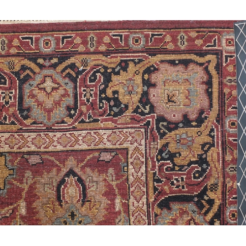 2047 - Rectangular Indian rug having an all over floral design onto a red ground, 223cm x 155cm...