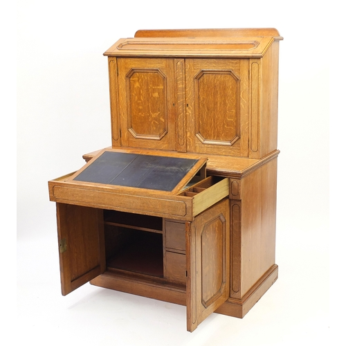 2008 - Oak Secretaire cabinet, the superstructure fitted an arrangement of pigeon holes and drawers above a...