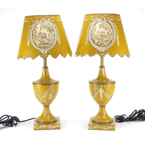 2016 - Pair of Toleware lamps with shades, each hand painted with panels of figures and foliate motifs, eac...