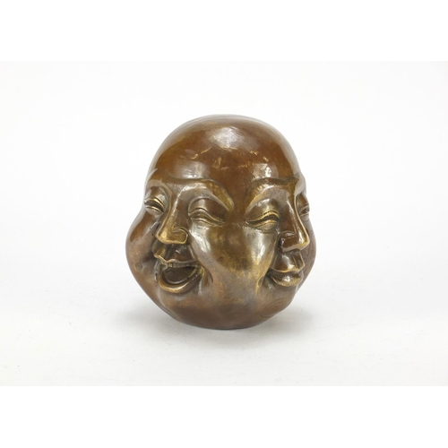 2055 - Chinese patinated bronze four sided Buddha head paperweight, character marks to the base, 15cm high...