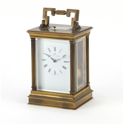 2056 - Large brass cased repeating carriage clock striking on a gong by Matthew Norman, the enamelled dial ...