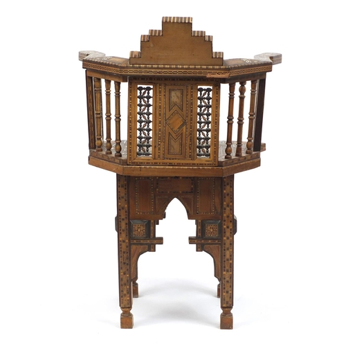 2001 - Moorish design elbow chair, with geometric parquetry inlay, probably Syrian, 88cm high...