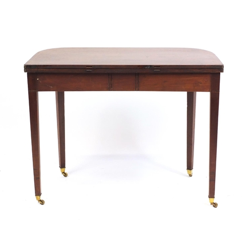 2014 - Edwardian inlaid mahogany fold over tea table, raised on tapering legs, 72cm H x 91cm W x 45cm D (fo...