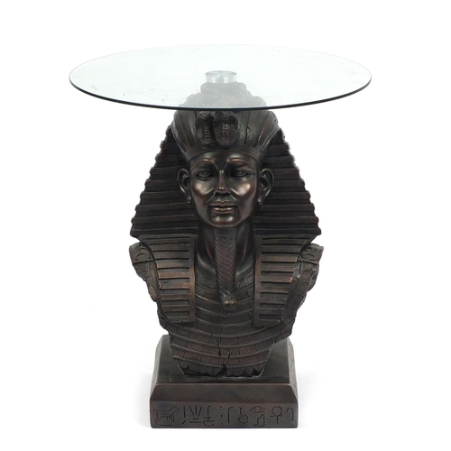 2013 - Bronzed Tutankhamun coffee table with glass top, 53cm high x 47cm in diameter...