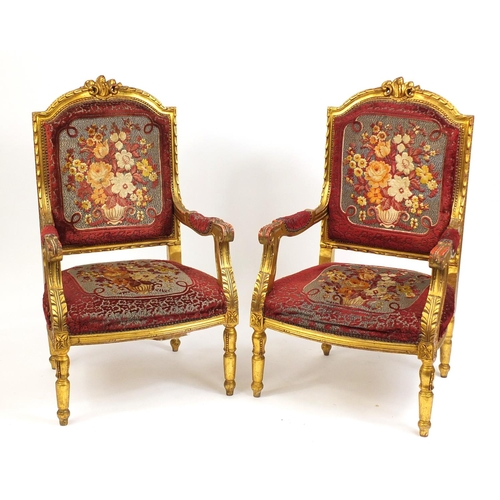 2015 - Pair of French design gilt wood elbow chairs with red and floral upholstery, 111cm high...