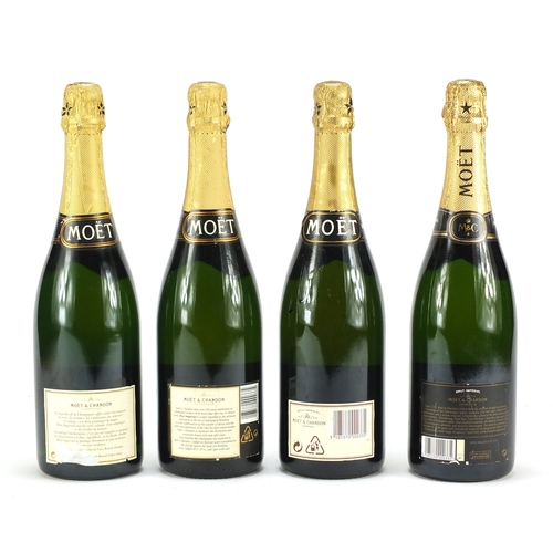 2051a - Four bottles of Moet & Chandon champagne...