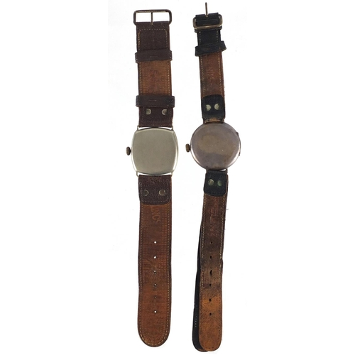 706A - Two Military interest trench watches, one with silver case, each with luminous hands and dial, the l...