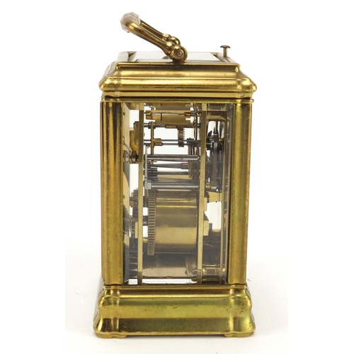 5 - Brass cased repeating carriage clock striking on a gong having an enamel dial with Roman numerals, 1...