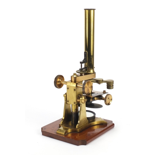 40 - Victorian brass microscope with accessories and case by J & C Arobbins of London, 34.5cm high...
