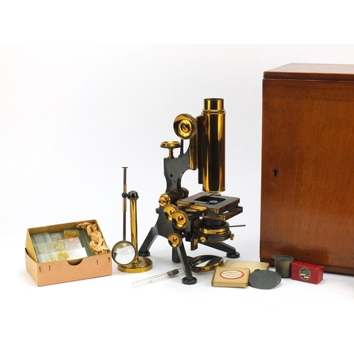 27 - Victorian brass monocular microscope with accessories and case by W Watson and Sons of London, numbe...