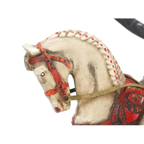 54 - Vintage Courvoisier advertising figure on horseback, 33.5cm high...