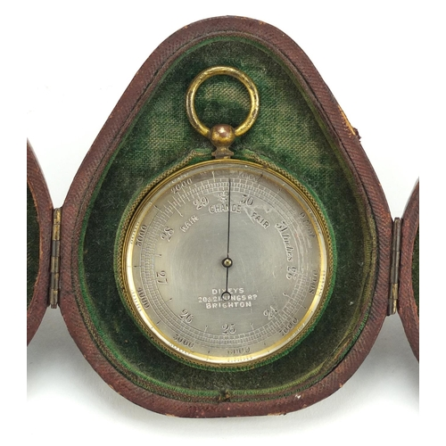 18 - Brass cased pocket barometer by Dixeys, with fitted case and unassociated compass, 9.5cm high...