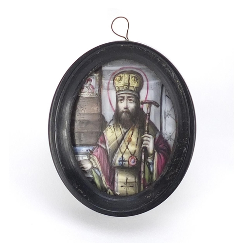 25 - Antique Russian enamel icon hand painted with a St Joseph, housed in an ebonised framed, script to t...