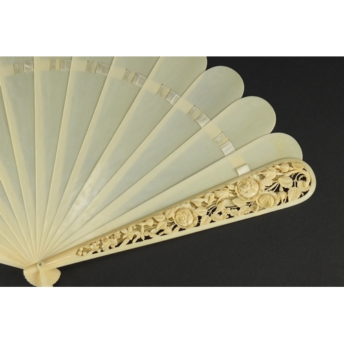 38 - Victorian ivory fan, the front guard finely carved and pierced with flowers and foliage, 20cm in len...
