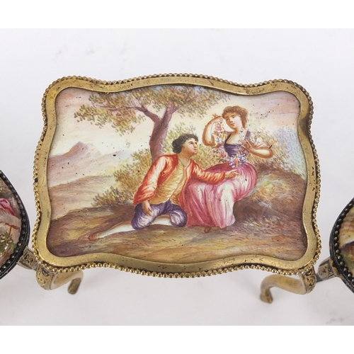 11a - 19th century enamel dolls house furniture with gilt metal mounts, probably french, comprising two se...