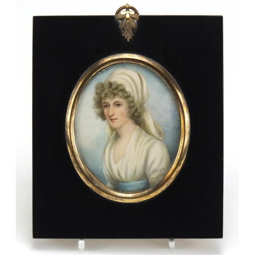 38 - 19th Century oval hand painted portrait miniature of a young female, housed in an ebonised frame, in...