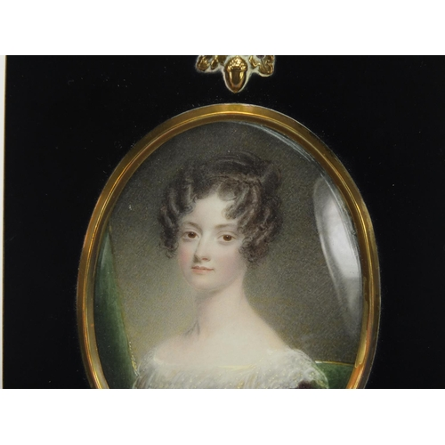 41 - 19th century oval hand painted portrait miniature of a young female, housed in an ebonised frame, 9....