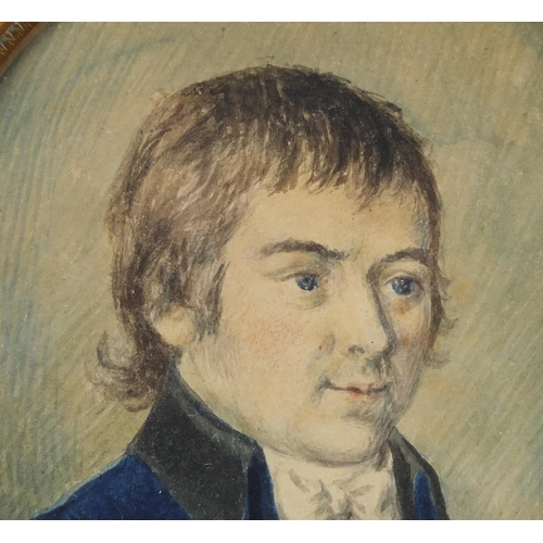 47 - Georgian oval watercolour portrait miniature of a young gentleman housed in a brass mount, 11cm x 8....