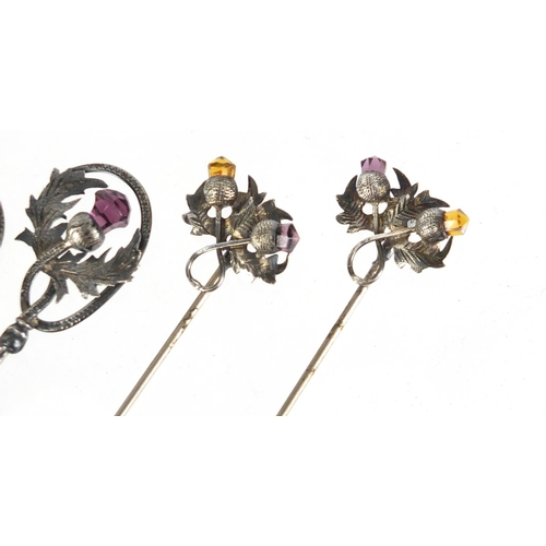 12 - Two pairs of unmarked silver thistle design hat pins set with amethyst and citrine, the largest 28.5...