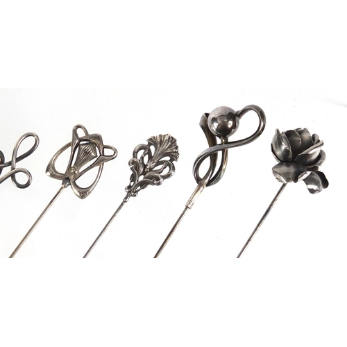 9 - Six Art Nouveau silver hat pins, various hallmarks, the largest 26.8cm in length...