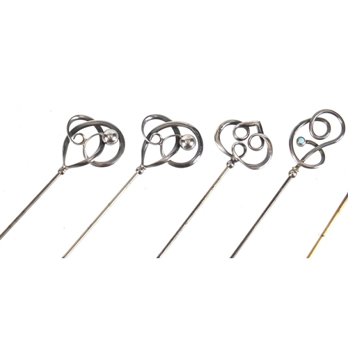 13 - Six Art Nouveau silver hat pins by Charles Horner, one set with turquoise, the largest 22.8cm in len...