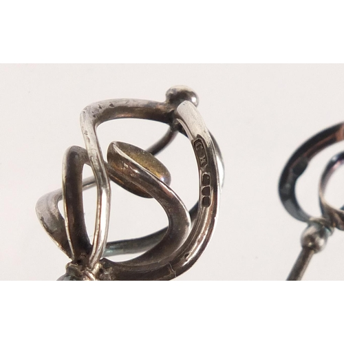 14 - Three pairs of Art Nouveau silver hat pins by Charles Horner, the largest 16.7cm in length...