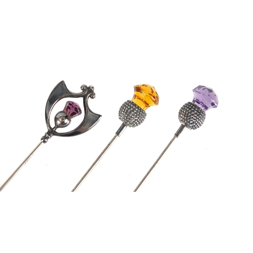 6 - Three Art Nouveau silver thistle design hat pins set with amethyst and citrine, one by Charles Horne...