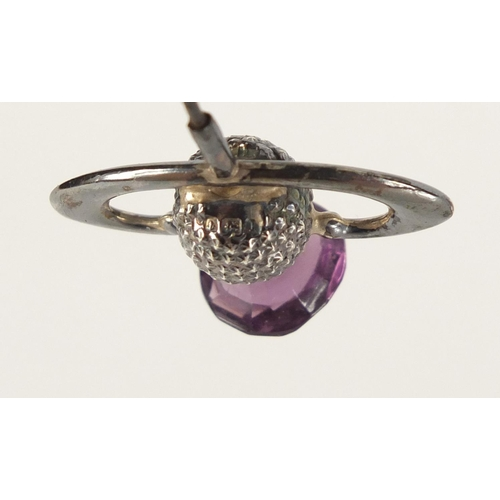 7 - Three Art Nouveau unmarked silver thistle design hat pins set with amethyst and citrine, the largest...
