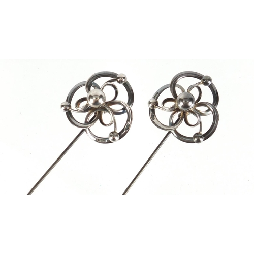 3 - Pair of Art Nouveau silver hat pins by Charles Horner, Chester 1913, each 22cm in length...