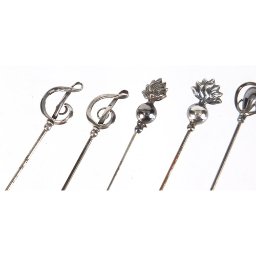 11 - Six silver hat pins including a pair by Charles Horner, the largest 17cm in length...