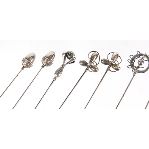 10 - Nine silver hat pins including three pairs, some by Charles Horner, various hallmarks, the largest 2...