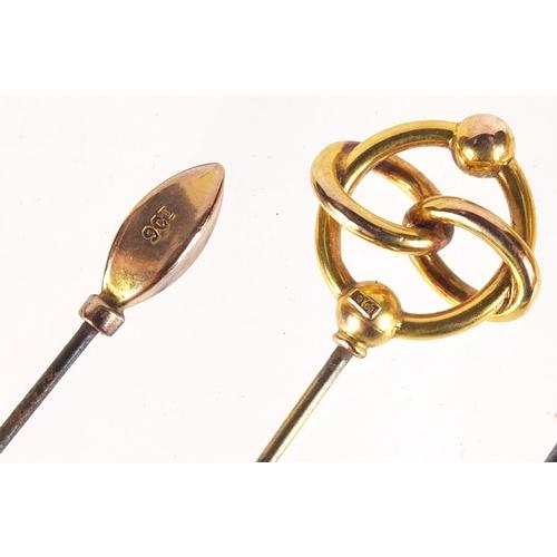 19 - Four Art Nouveau 9ct gold hat pins, the largest 19.5cm in length...