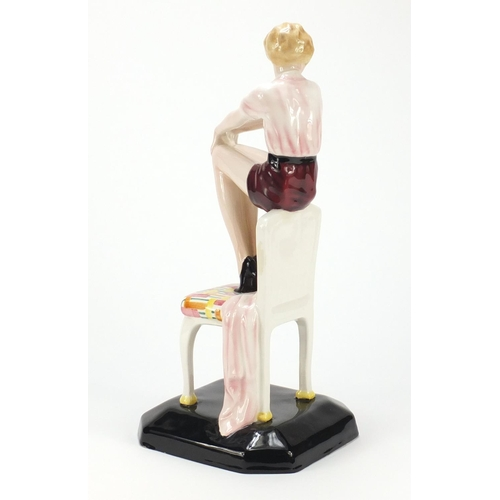 605 - Austrian Art Deco figurine of a girl seated on a chair by Goldscheider, modelled by Lorenzl factory ...