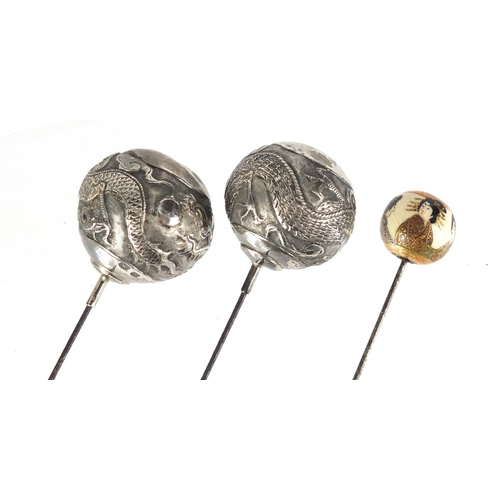 17 - Pair of Chinese silver hat pins and a Japanese Satsuma example, the pair by Po Cheng, the largest 26...