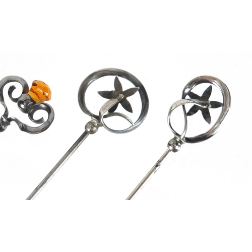 8 - Two pairs of Art Nouveau silver hat pins by Charles Horner, comprising two set with citrine and two ...