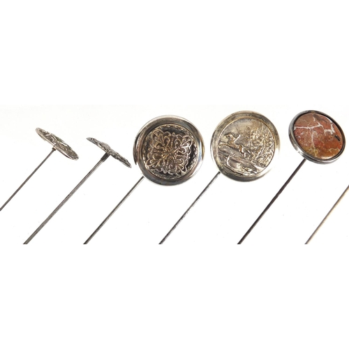 16 - Seven vintage hat pins including two Art Nouveau silver examples and two enamelled, the largest 26.7...