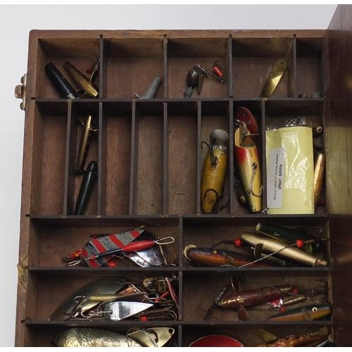 140 - Collection of vintage fishing lures including some hand painted, possibly some by Hardy, housed in a...