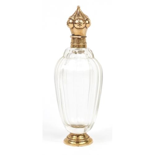 22 - Dutch cut glass scent bottle with 14K gold mounts, impressed oak leaf to the mounts, 10.5cm high...