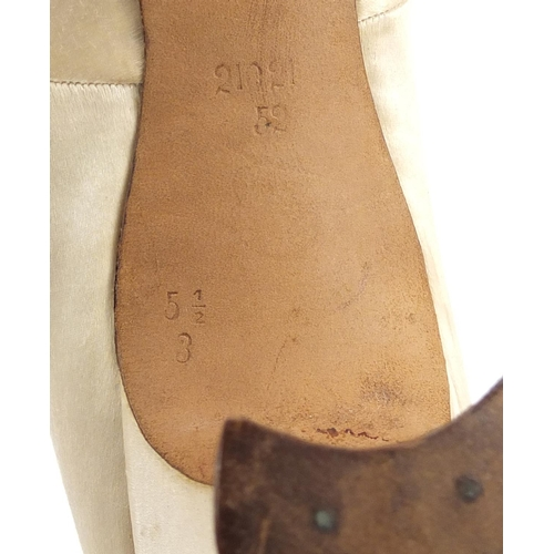 32 - Pair of Victorian silk embroidered shoes, size 5 1/2, each numbered 21021 52 to the underside...
