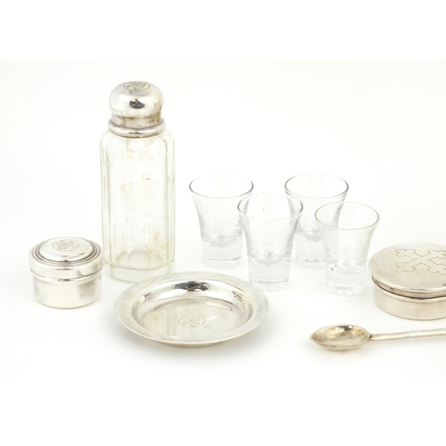 55 - Two travelling holy communion sets, one by William Beardsley, the glass bottles with silver lids, th...